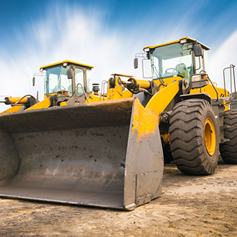 Two parked wheel loaders
